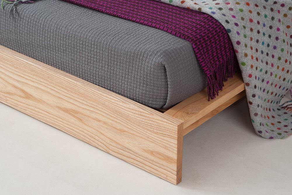 Ki low wooden loft bed, foot end detail view