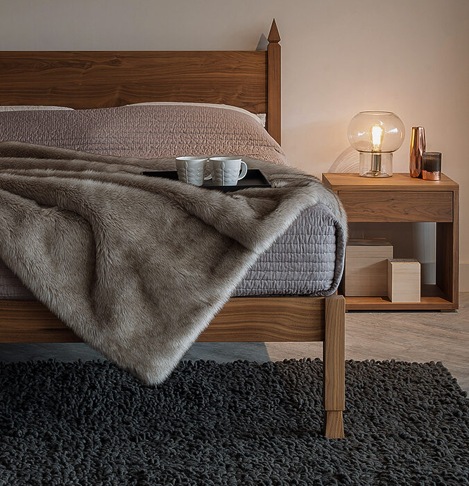 The Samarkand Indian inspired bed in Walnut shown with a Walnut Cube bedside table.