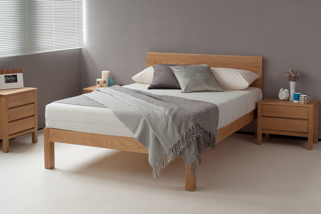 contemporary solid wood Tibet bed in Oak shown with Black Lotus Shaker storage drawers