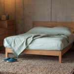 Contemporary Oak bedroom furniture solid wooden Malabar Bed with Cube collection chests of drawers.