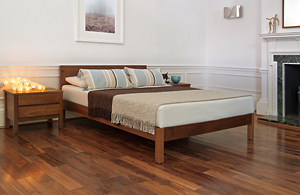 classic bedroom setting with walnut sahara low wooden bed and Shaker bedside drawers