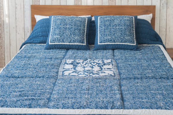 blue embroidered bedspread