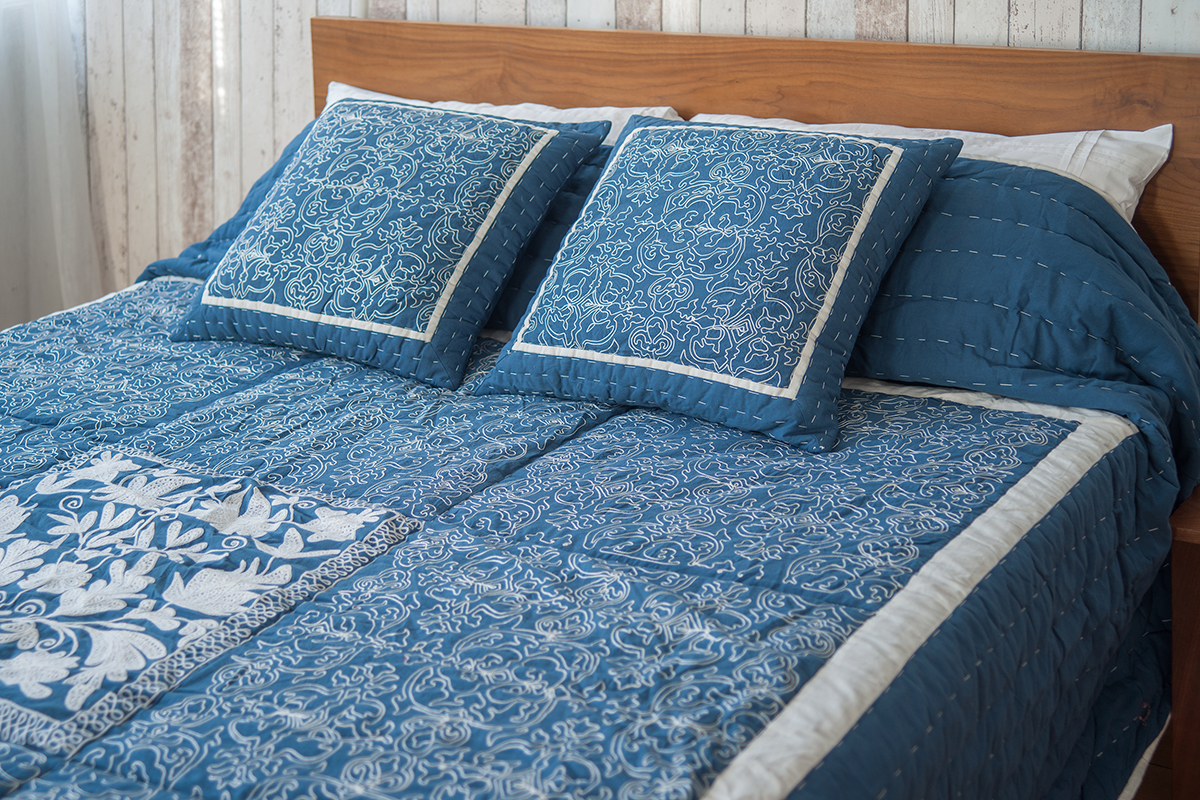 Embroidered quilt and cushions