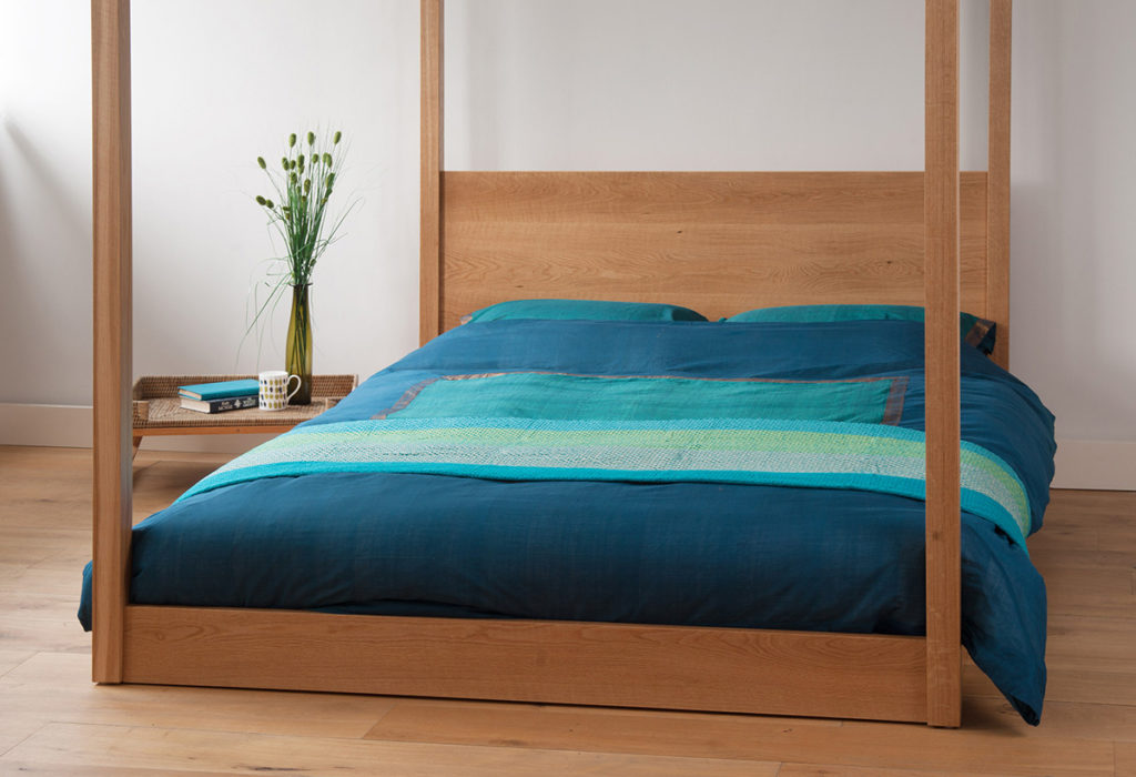 Our Oak 4 poster Kingsize Cube bed with striking teal blue duvet cover.
