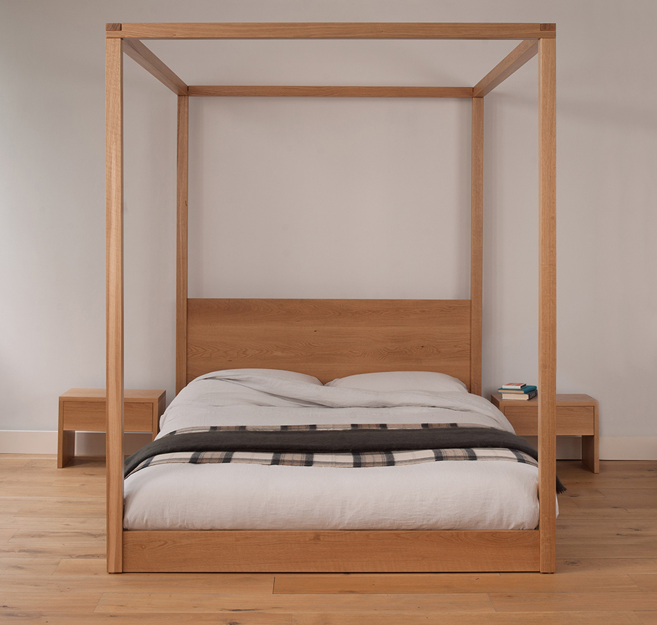 Cube - a low elegant and modern four poster bed. Hand made in Britain from solid wood.