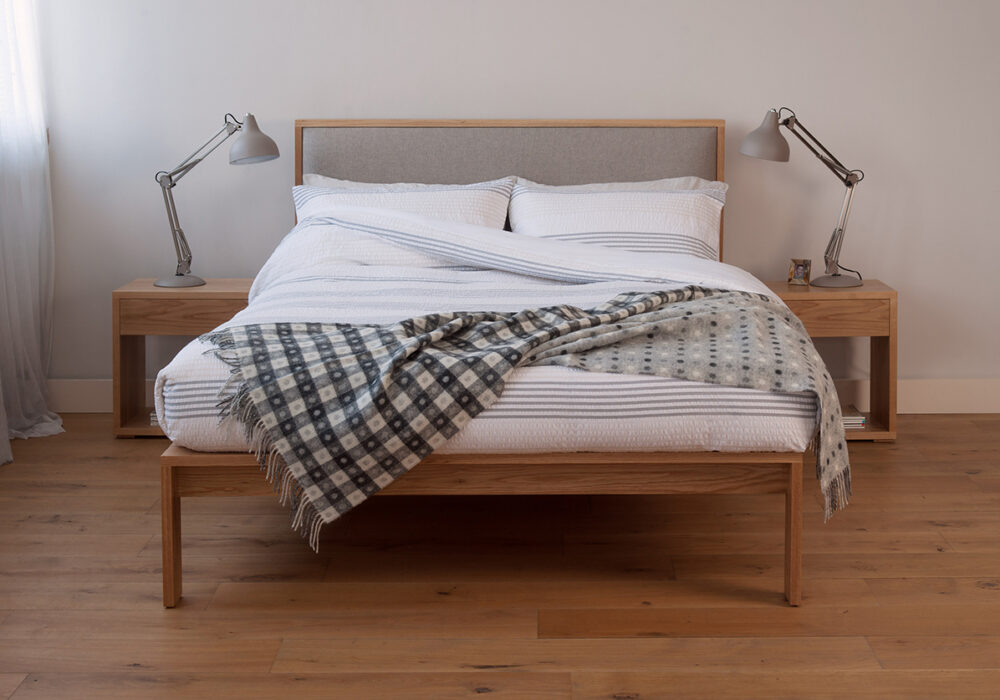 Contemporary bedroom with Shetland, a wooden bed with padded headboard