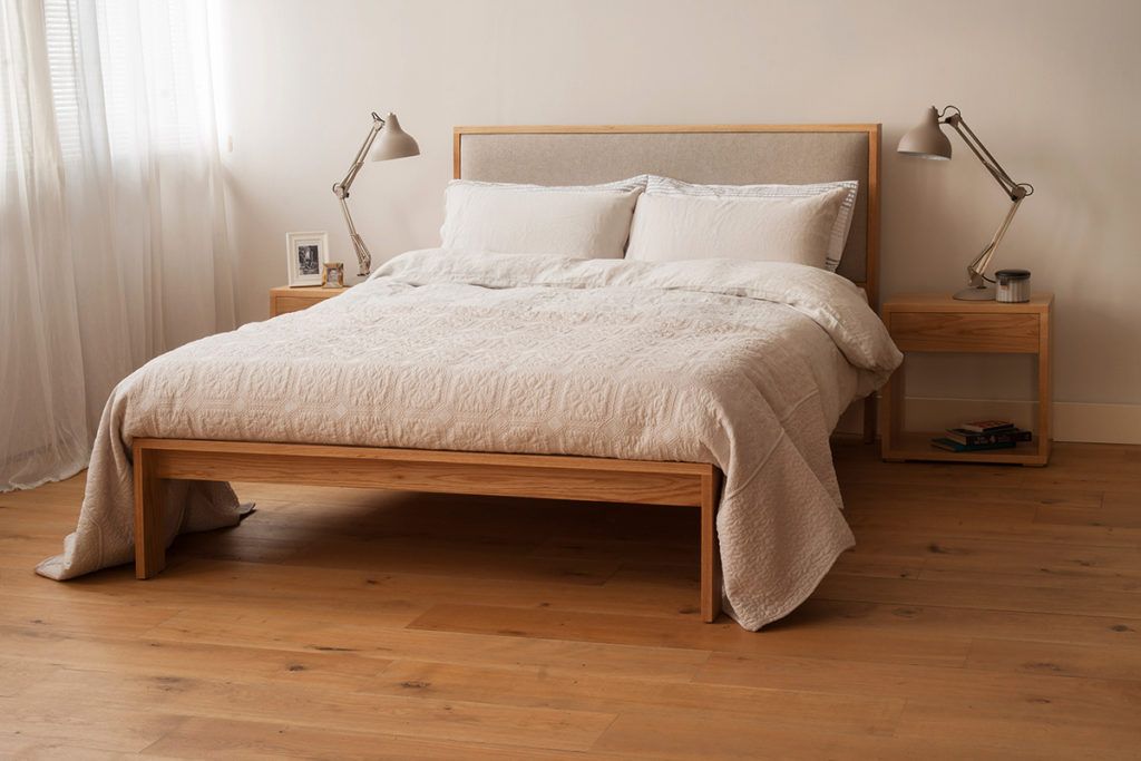 Shetland wooden bed frame with padded headboard in neutral colours bedroom