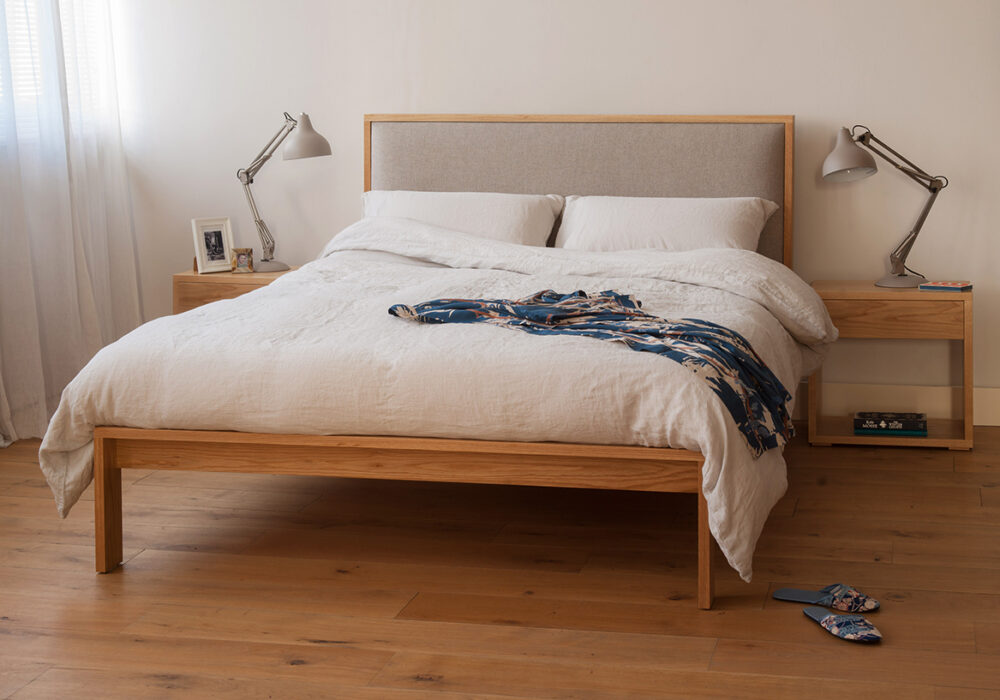 Shetland contemporary wooden bed with padded headboard, here in Oak with oak bedside tables