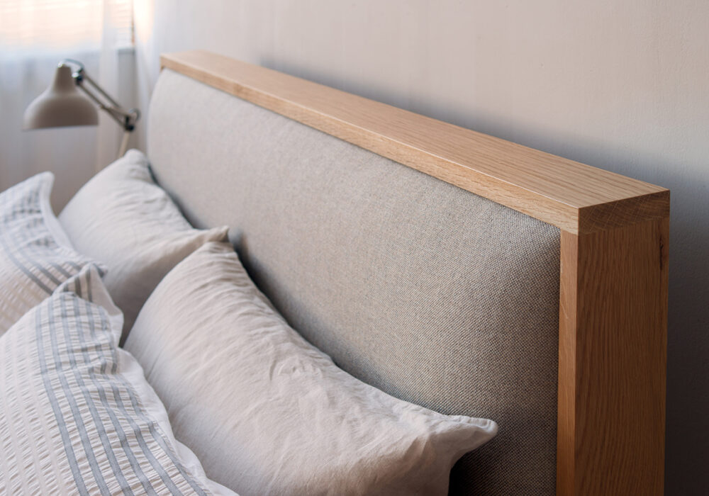 A closer view of the Shetland wooden bed padded headboard