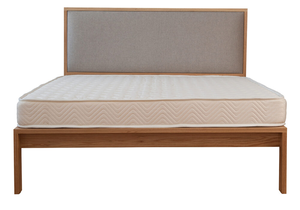 Shetland modern wooden taller bed with padded headboard shown without bedding