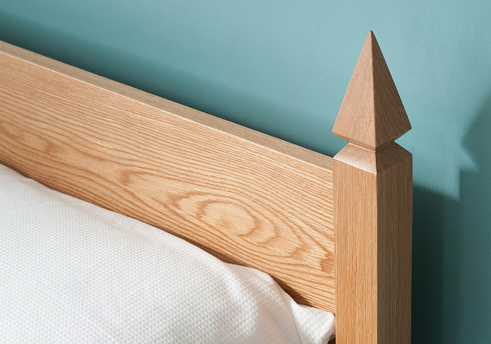 A close up of the Mandalay bed headboard post made from solid Oak