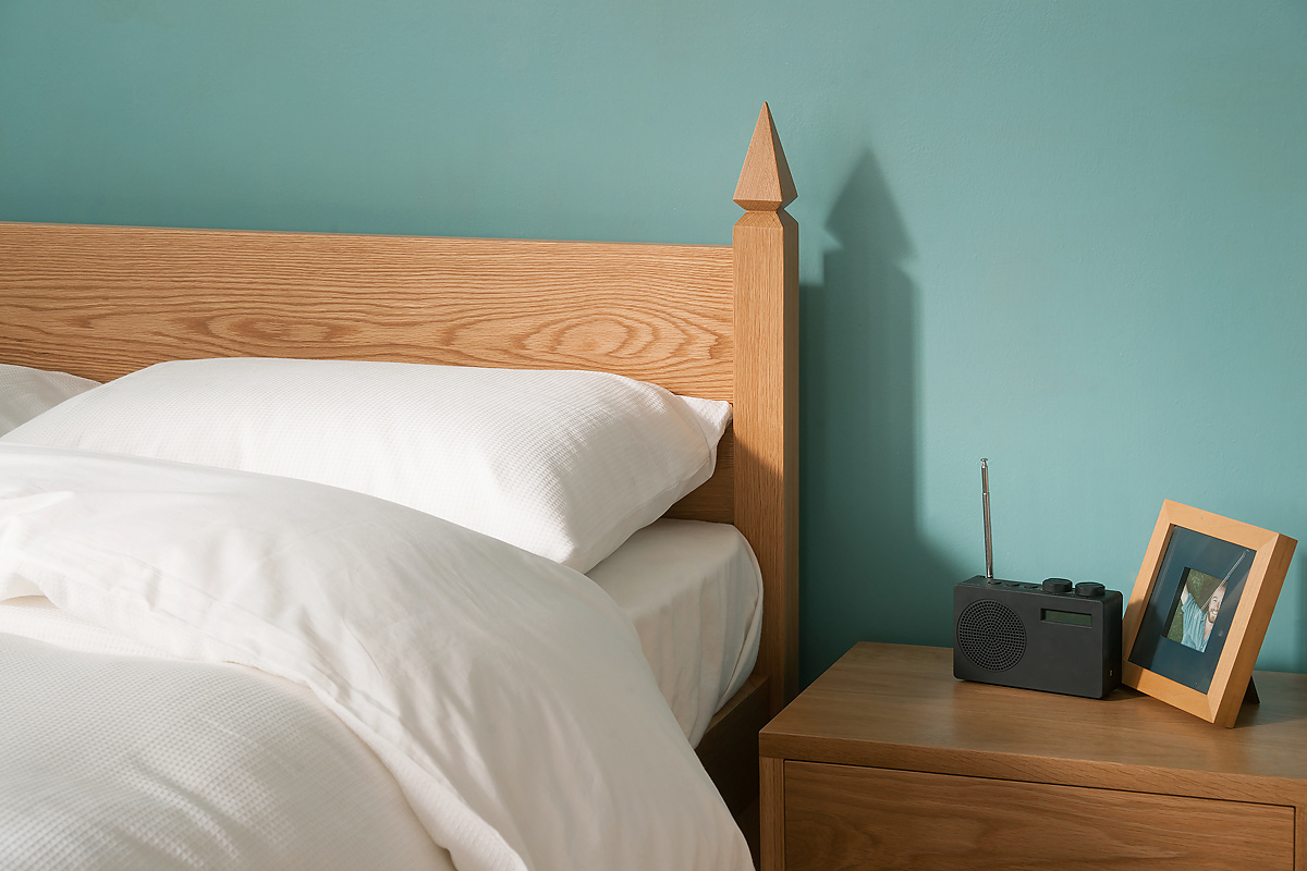 The Mandalay wooden bed headboard in Oak