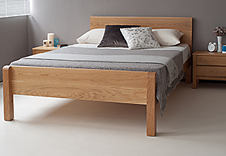 oak Tibet, a solid wooden bed shown here with a footboard available on request
