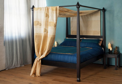 Raj an Indian style four poster bed made from solid wood