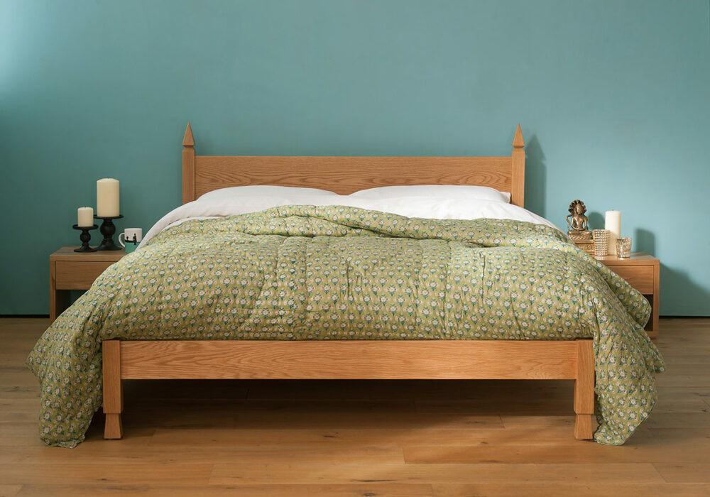 Our Indian style Mandalay bed made from solid Oak with hand carved details