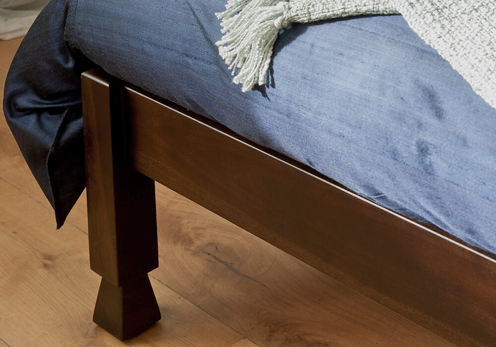 A close up photo showing the Samarkand bed carved wooden leg detail