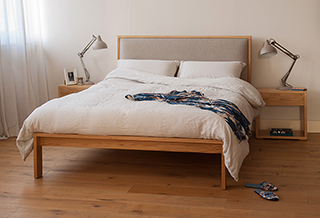 Contemporary bedroom with Oak Shetland wooden bed and Cube bedside Tables in Oak