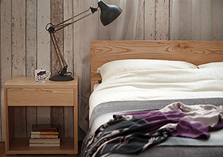 A rustic bedroom look featuring an ash wood Malabar bed and Cube Bedside table.