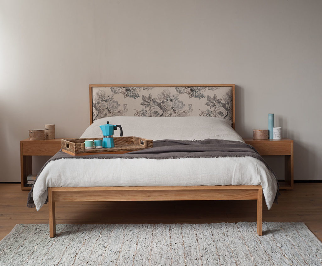 Shetland classic wooden bed with upholstered headboard shown with matching oak bedside tables