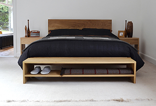 Malabar a low modern wooden bed shown here in Oak and with an end of bed storage bench