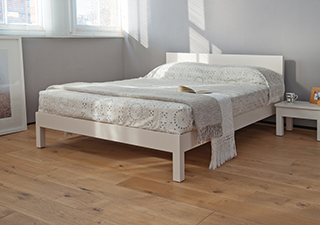 white painted low wooden Sahara bed and bedside table