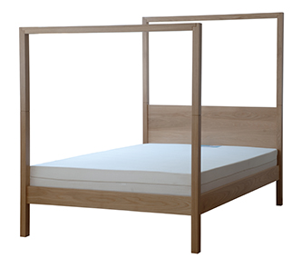 A plain view of the Oasis modern 4 poster bed made in Oak