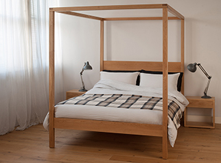 Contemporary classic Orchid four poster wooden bed here shown in oak