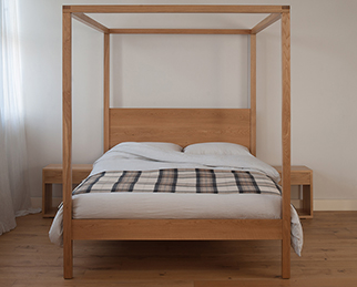 A contemporary solid wood 4 poster bed, the Orchid, available in a choice of timber and in a range of sizes