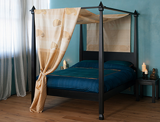 Our Raj wooden 4 poster bed has tapering posts and carved details