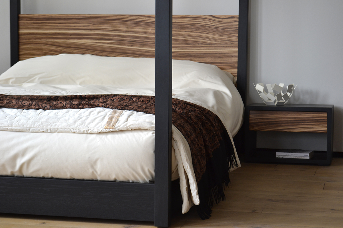 Unique and bespoke black oak and zebrano wood Cube 4-poster bed and bedside table.