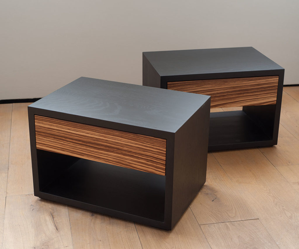Bespoke Cube bedside tables in Black Oak with Zebrano wood drawer fronts.