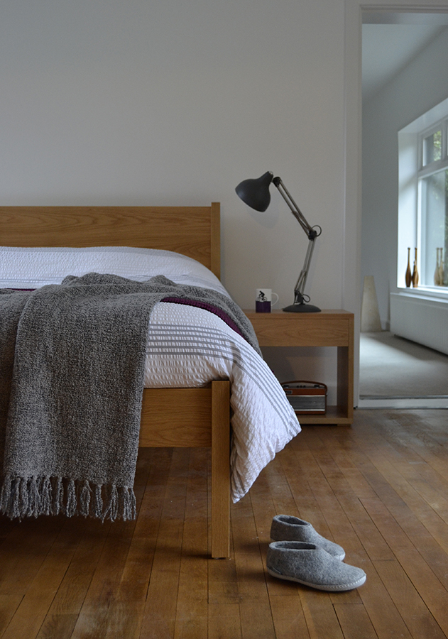 Felted wool slipper shoes with Classic Zanskar bed and Cube bedside table.