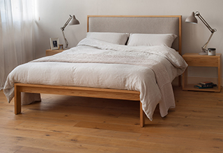 Summer bedroom styles, linen bedding on our Oak Shetland contemporary wooden bed