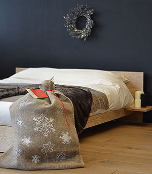 Kulu low wooden bed with Santa sack