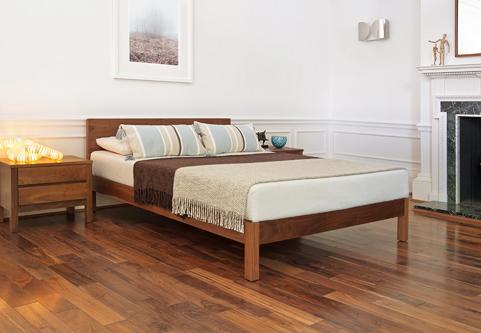Scandinavian chic bedroom with solid walnut low wooden Sahara bed