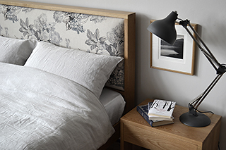 Scandinavian look oak Shetland bed frame with floral covered padded headboard