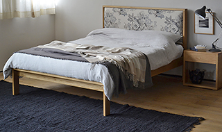 Shetland an oak bed with upholstered headboard panel in floral fabric