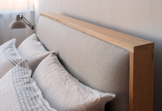Modern oak bed with upholstered headboard