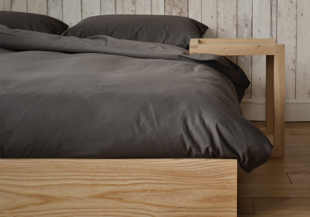 Ki ultra low wooden bed made from solid Ash & shown with Frame bedside table