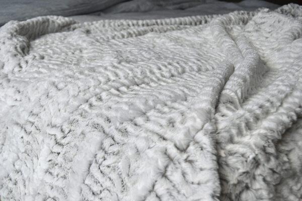 white faux fur throw