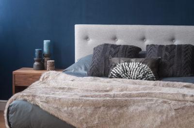 Arran smoke grey bedding and beige faux fur throw