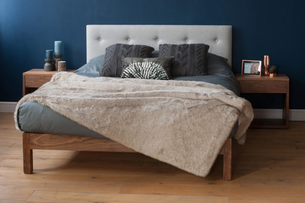 Arran bed with upholstered headboard in grey wool fabric and a walnut frame