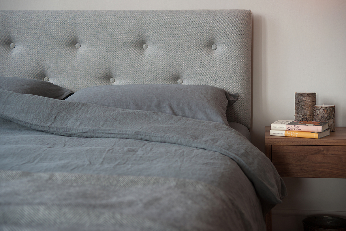 buttoned headboard bed with linen bedding