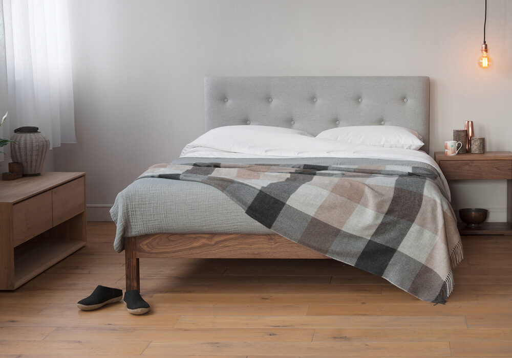 The Arran Bed with buttoned padded headboard and a solid Walnut frame.