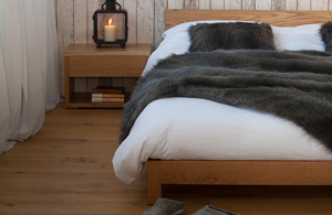 Cosy rustic styled Nevada Bed with low Cube bedside table.
