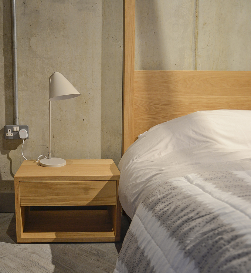Cube a contemporary solid wood 4 poster bed with cube 1 drawer bedside table.