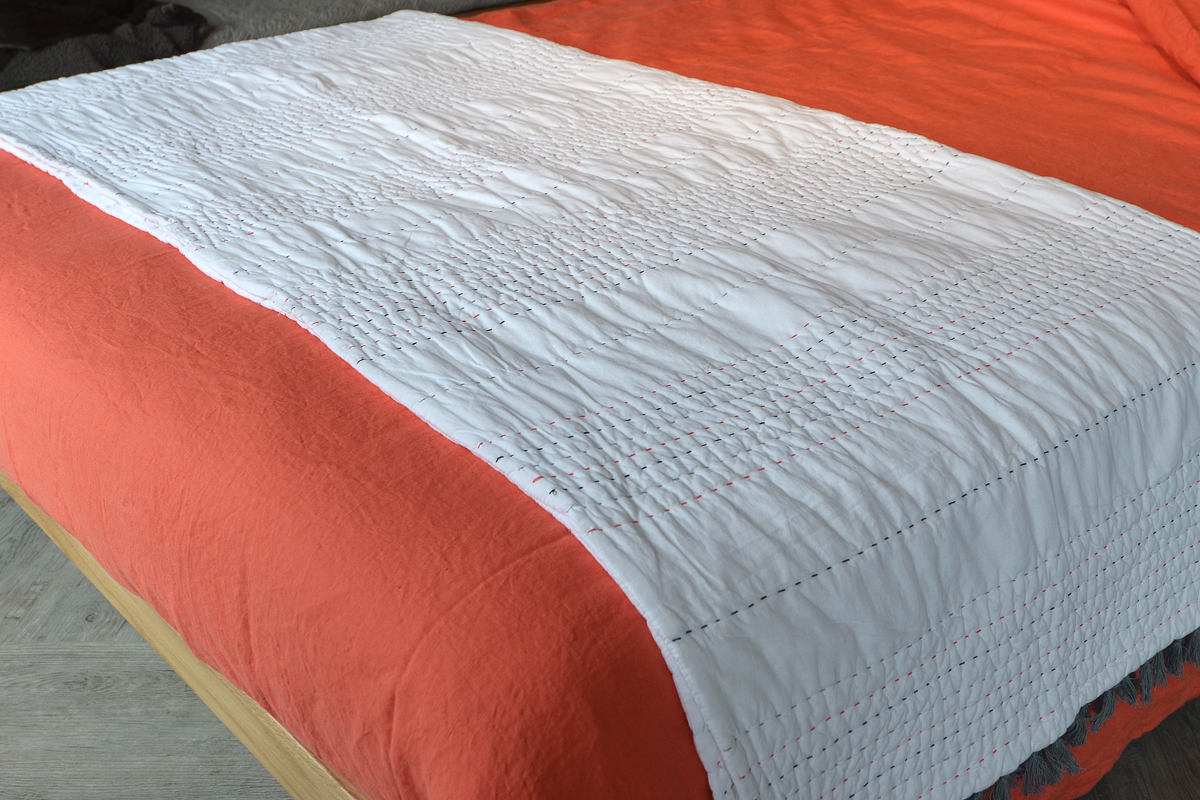 lisbon coral linen and chain stitched quilt