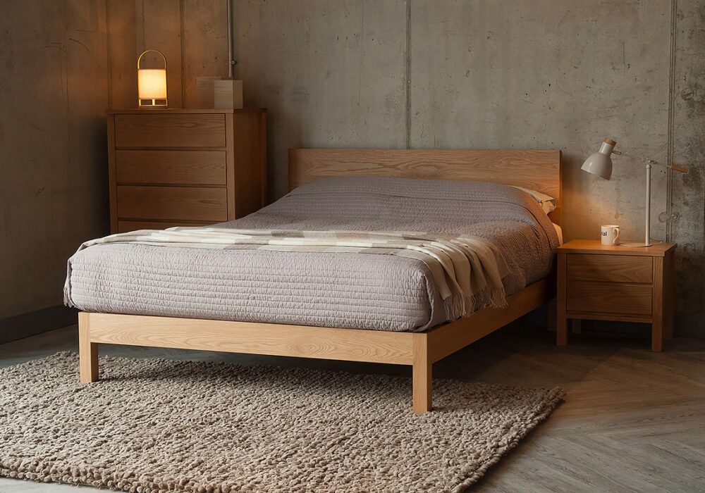 Contemporary Oak Malabar bed shown with Oak Shaker storage drawers