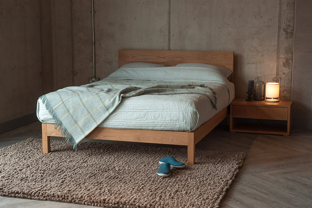 Contemporary solid wood Malabar bed with Cube bedside table all in Oak.