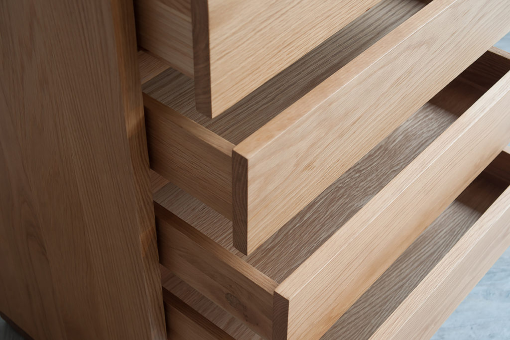 close-up shot of a 5 drawer Cube storage chest in Oak, drawers open